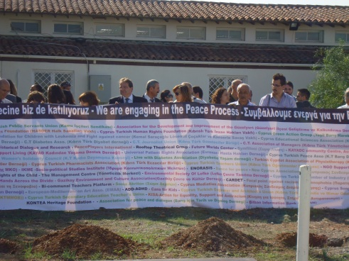 Representatives of civil society organisations, holding the banner.