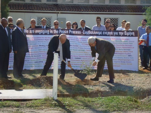 Mr Talat and Mr Christofias plant the trees
